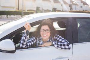happy women with new car loan